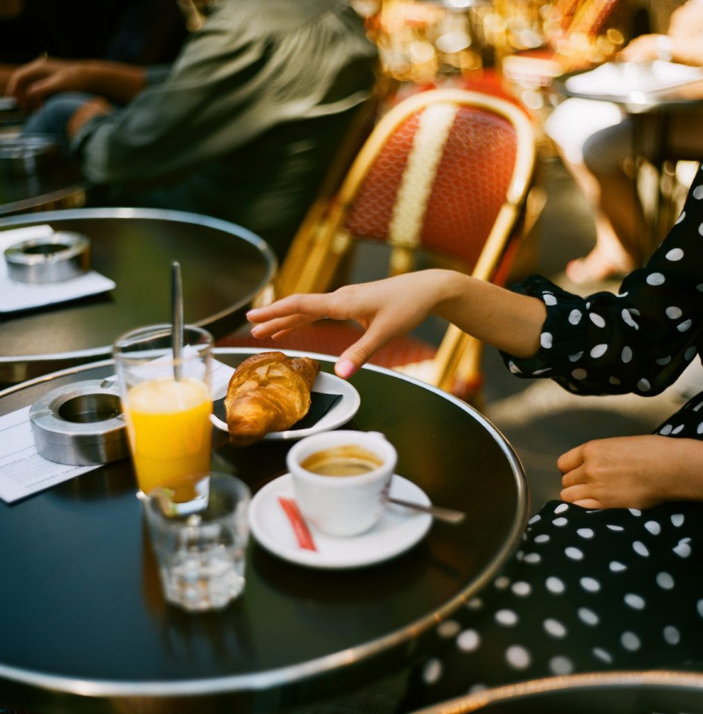 Paris Guide: Paris breakfast with Croissant, coffee and orange juice.