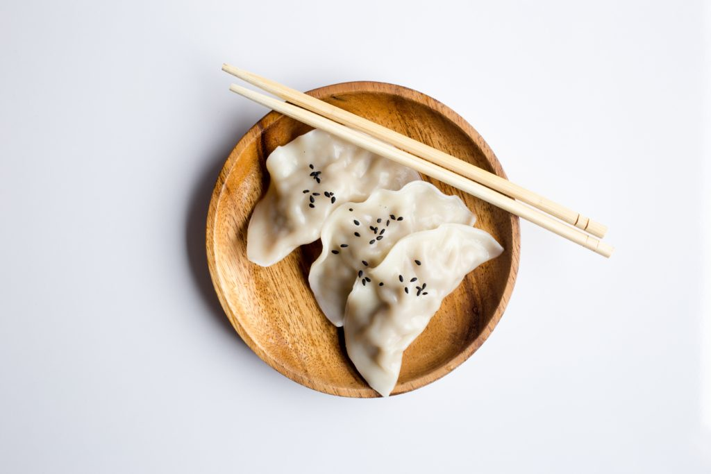 Asian food (dumplings) and chopsticks, not from KuYa Malta